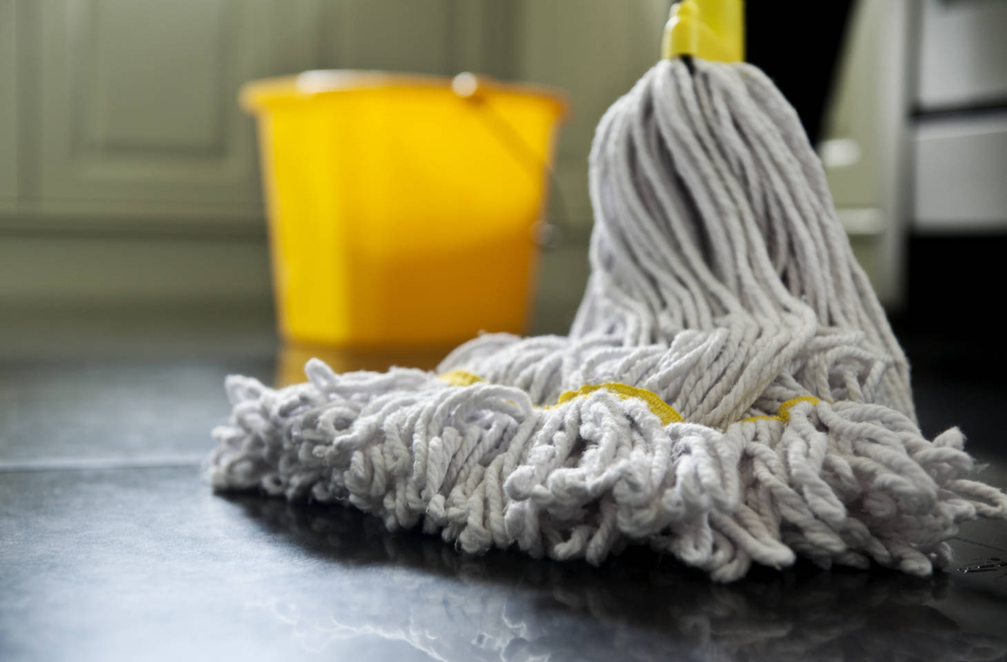 mop and bucket on kitchen floor