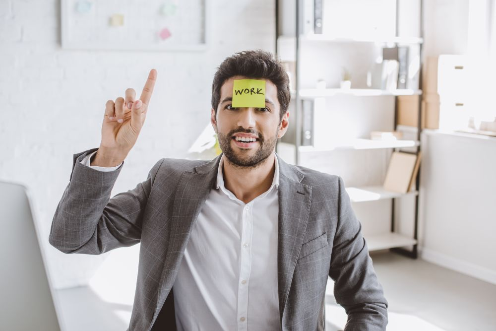 Sticky note on man's forehead
