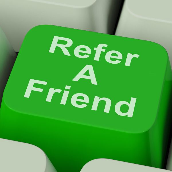 Close up of a keyboard key that says refer a friend