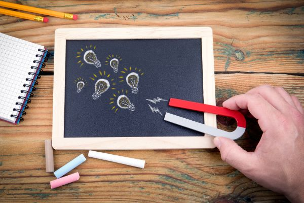 Chalkboard on table with magnet attracting leads
