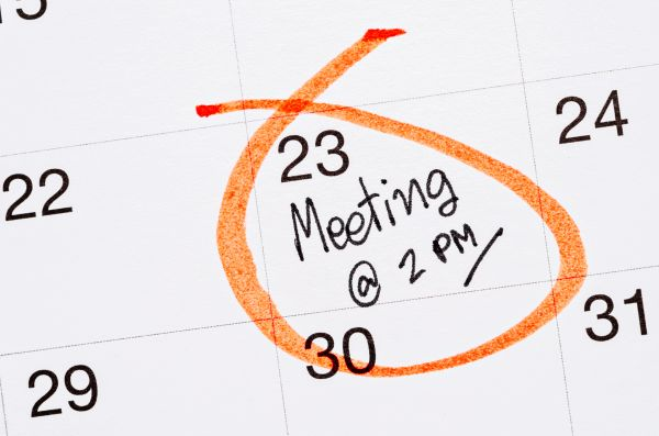 Close up of calendar with scheduled meeting