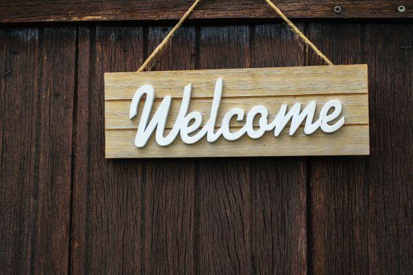 Welcome sign hanging on door