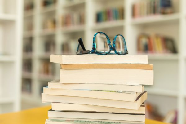 Glasses on top of a stack of books