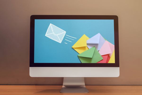 Computer monitor with an image of envelopes flying on the monitor screen