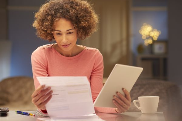 Woman at a desk reviewing her financial statement