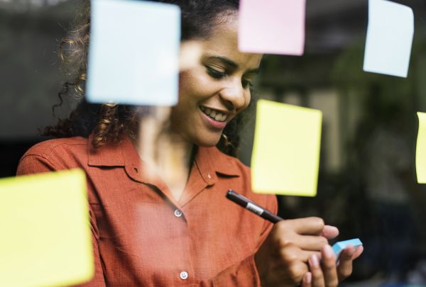 Woman with sticky notes planning