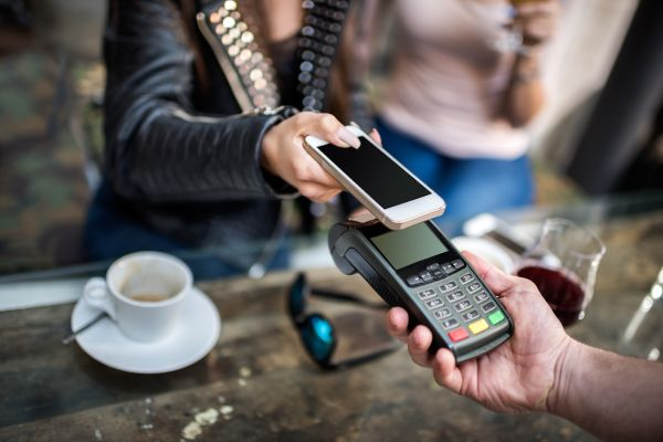Customer paying with mobile phone