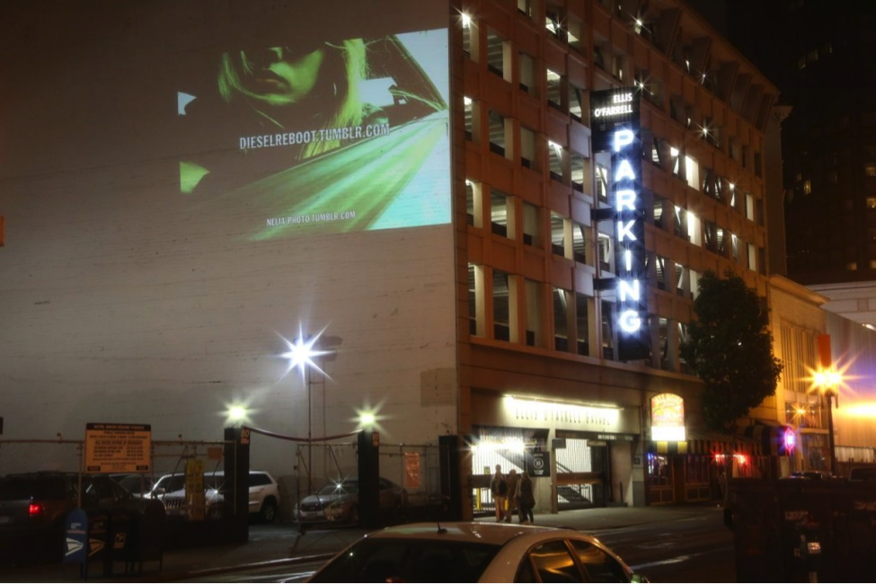 Guerrilla marketing: projecting video on building