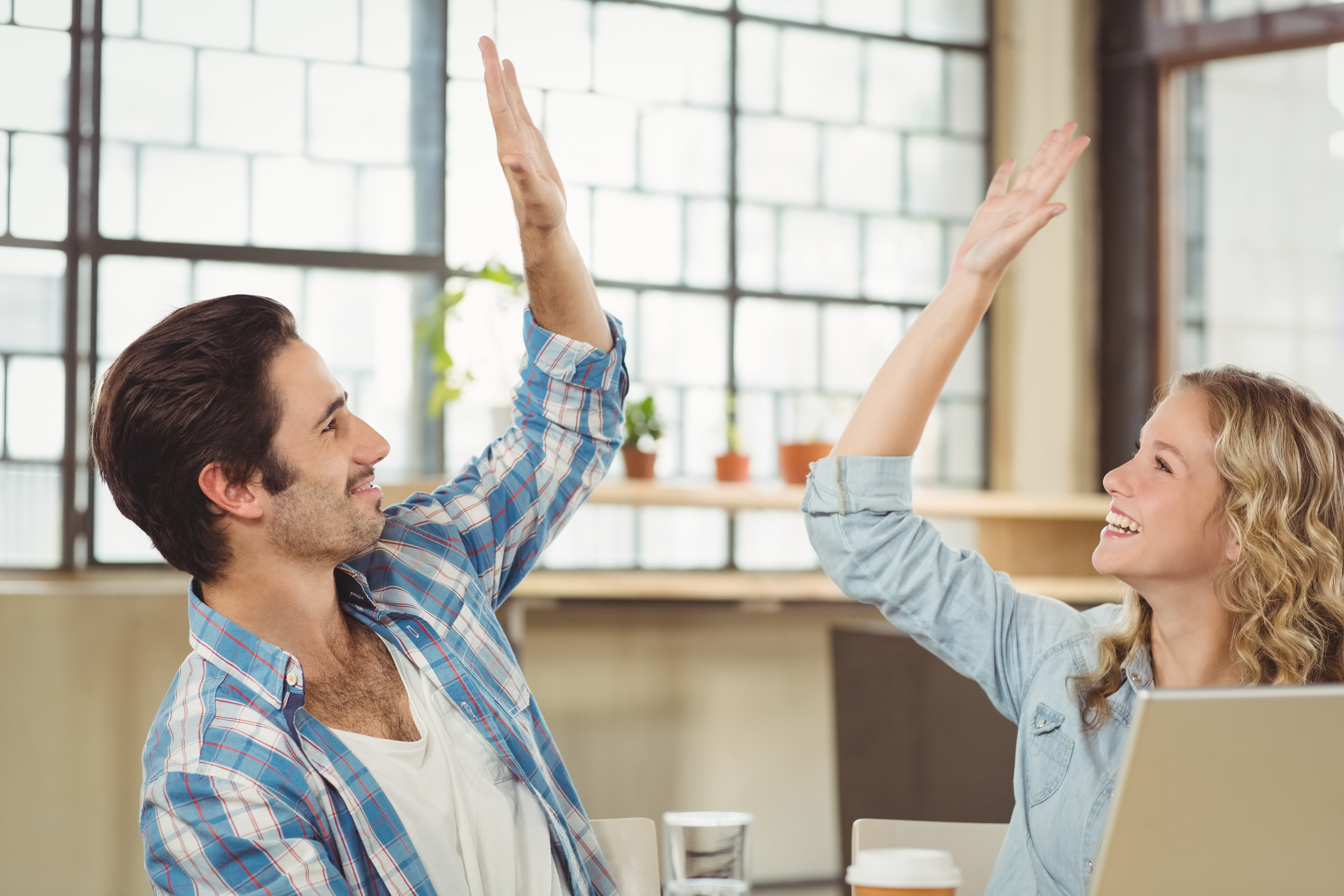 Colleagues giving high five