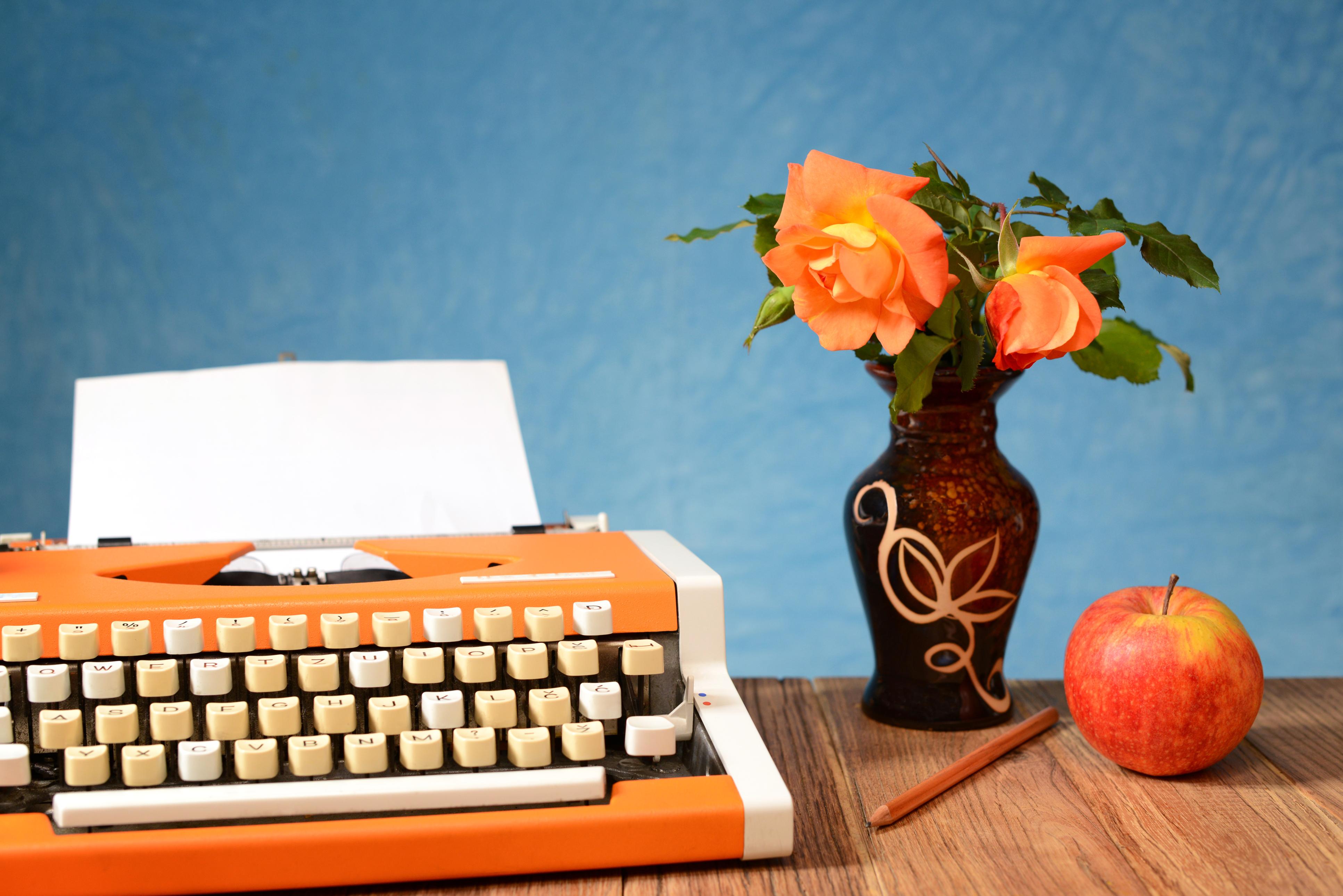 orange typewriter and roses.jpg